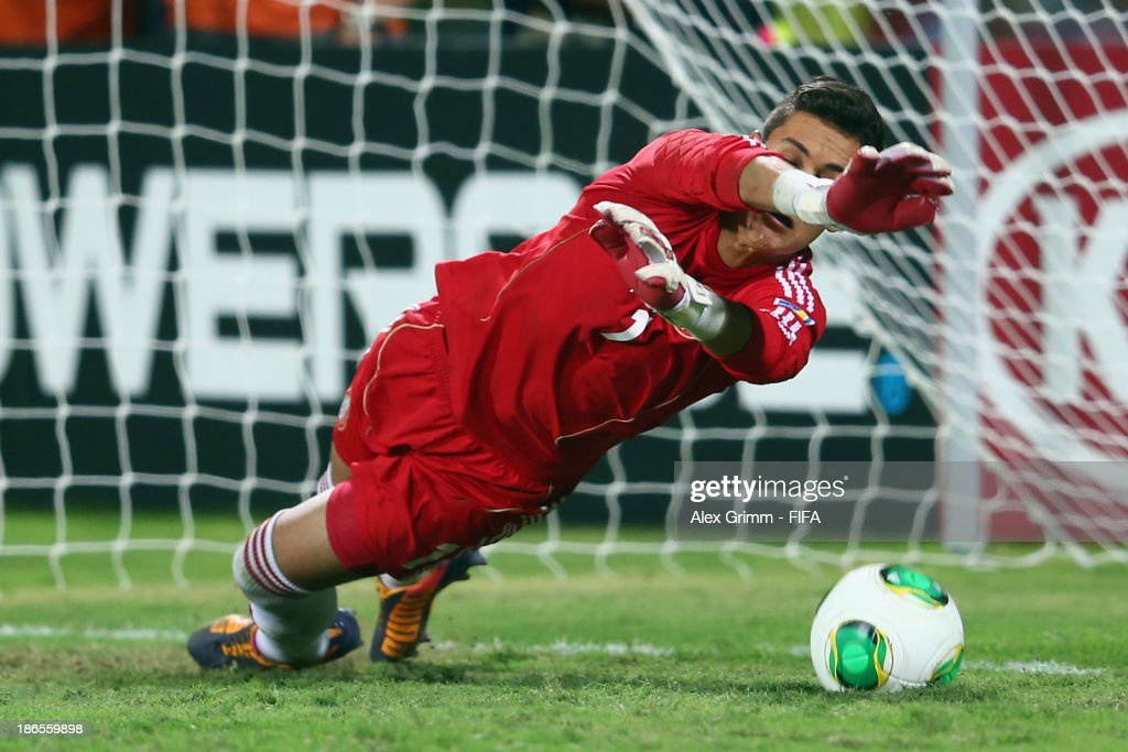 Goalkeeper Raul Gudino of Mexico saves a penalty of Mosquito of Brazil during the penalty shootout during the FIFA U-17 World Cup UAE 2013 Quarter Final match between Brazil and Mexico at Al Rashid Stadium on November 1, 2013 in Dubai, United Arab Emirates.