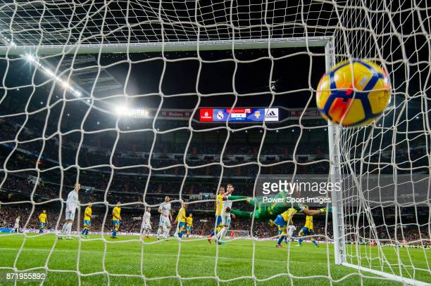 Goalkeeper Raul Lizoain Cruz of UD Las Palmas failed to stop the goal by Marco Asensio Willemsen of Real Madrid during the La Liga 201718 match...