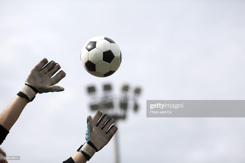 Goalkeeper reaching for ball : Stock Photo