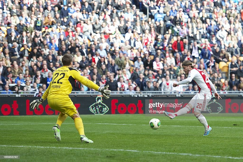 goalkeeper Remko Pasveer of Heracles Almelo, Lasse Schone of Ajax during the Dutch Eredivisie match between Ajax Amsterdam and Heracles Almelo at the Amsterdam Arena on April 7, 2013 in Amsterdam, The Netherlands.