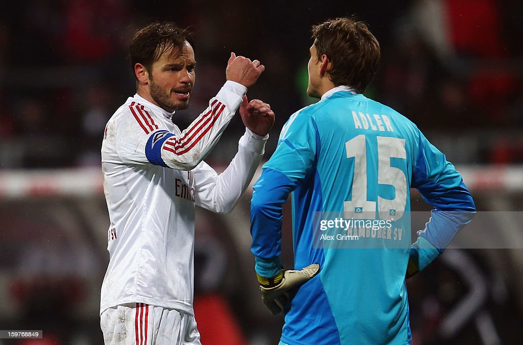 Goalkeeper Rene Adler and <a gi-track='captionPersonalityLinkClicked' href=/galleries/search?phrase=Heiko+Westermann&family=editorial&specificpeople=623650 ng-click='$event.stopPropagation()'>Heiko Westermann</a> of Hamburg discuss after the Bundesliga match between 1. FC Nuernberg and Hamburger SV at Easy Credit Stadium on January 20, 2013 in Nuremberg, Germany.