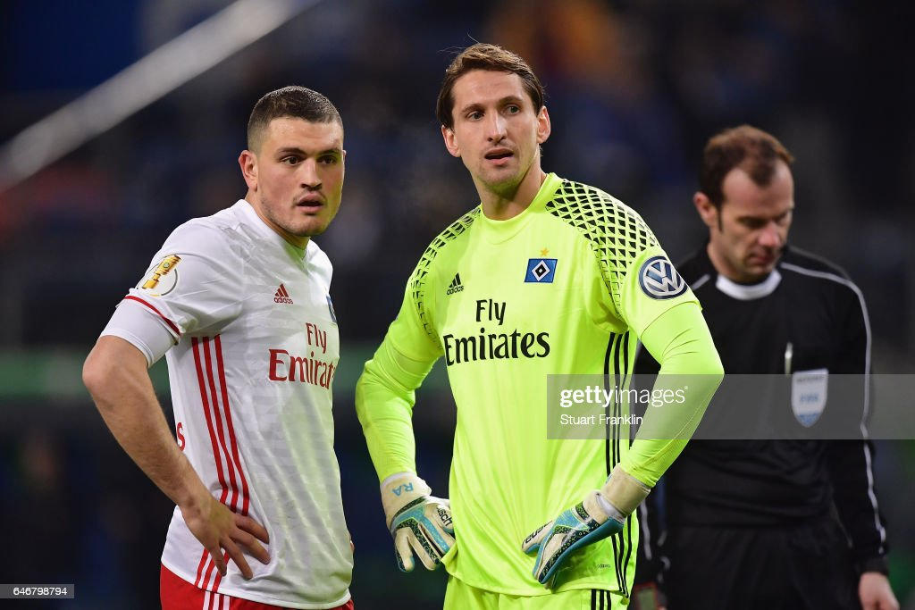 Goalkeeper Rene Adler and Kyriakos Papadopoulos of Hamburg react during the DFB Cup quarter final between Hamburger SV and Borussia Moenchengladbach at Volksparkstadion on March 1, 2017 in Hamburg, Germany.