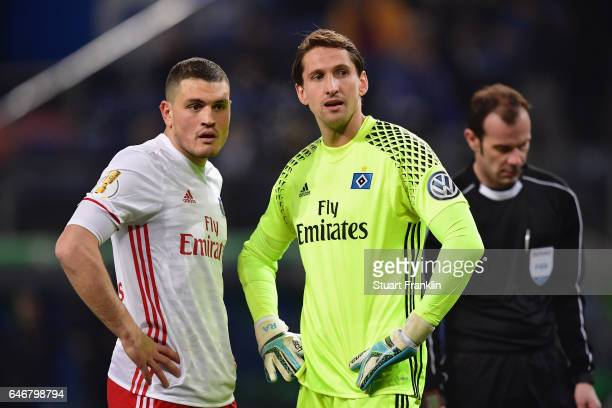 Goalkeeper Rene Adler and Kyriakos Papadopoulos of Hamburg react during the DFB Cup quarter final between Hamburger SV and Borussia Moenchengladbach...