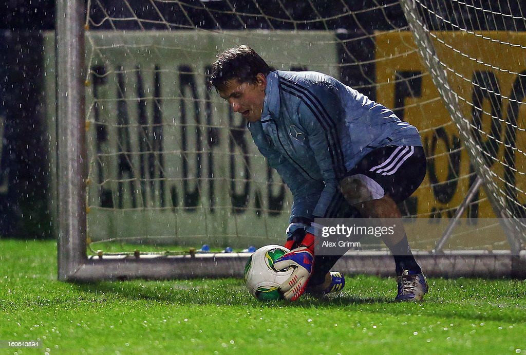 Goalkeeper <a gi-track='captionPersonalityLinkClicked' href=/galleries/search?phrase=Rene+Adler&family=editorial&specificpeople=686184 ng-click='$event.stopPropagation()'>Rene Adler</a> exercises during a Germany training session at Commerzbank-Arena on February 4, 2013 in Frankfurt am Main, Germany.