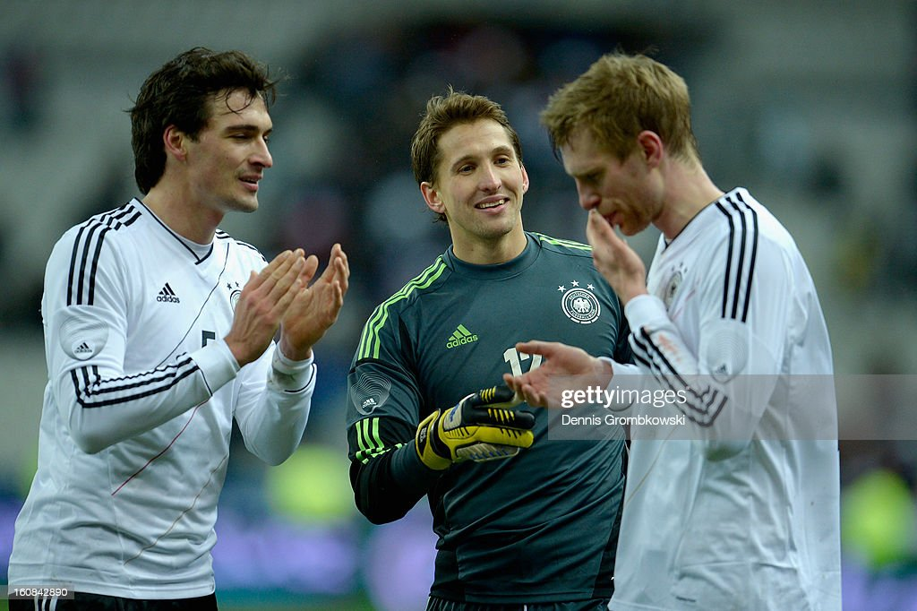Goalkeeper Rene Adler of Germany and teammates Mats Hummels and Per Mertesacker celebrate after the international friendly match between France and Germany at Stade de France on February 6, 2013 in Paris, France.