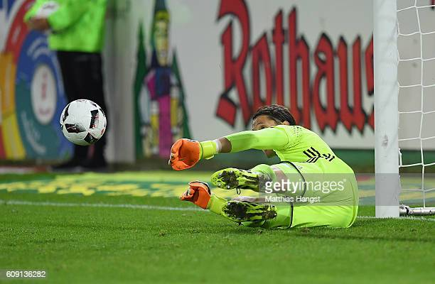 Goalkeeper Rene Adler of Hamburg misses to save the ball before the first goal of Nils Petersen of Freiburg during the Bundesliga match between SC...