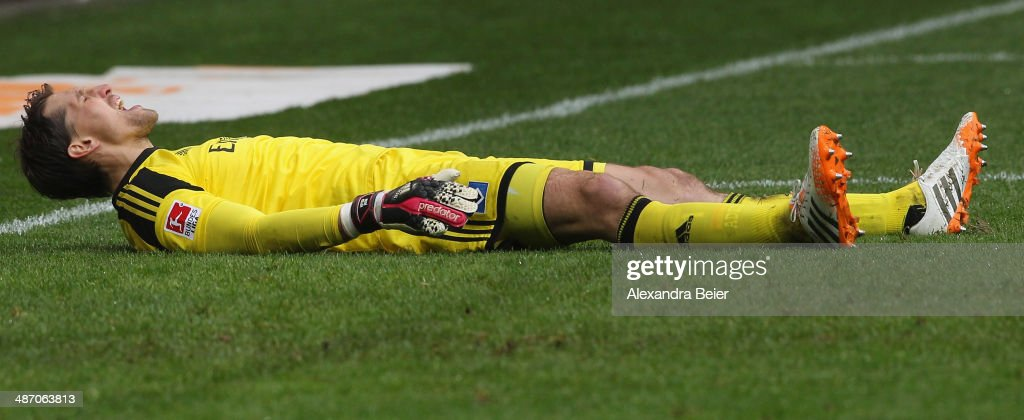 Goalkeeper <a gi-track='captionPersonalityLinkClicked' href=/galleries/search?phrase=Rene+Adler&family=editorial&specificpeople=686184 ng-click='$event.stopPropagation()'>Rene Adler</a> of Hamburg reacts after Augsburg's third goal during the Bundesliga match between FC Augsburg and Hamburger SV at SGL Arena on April 27, 2014 in Augsburg, Germany.