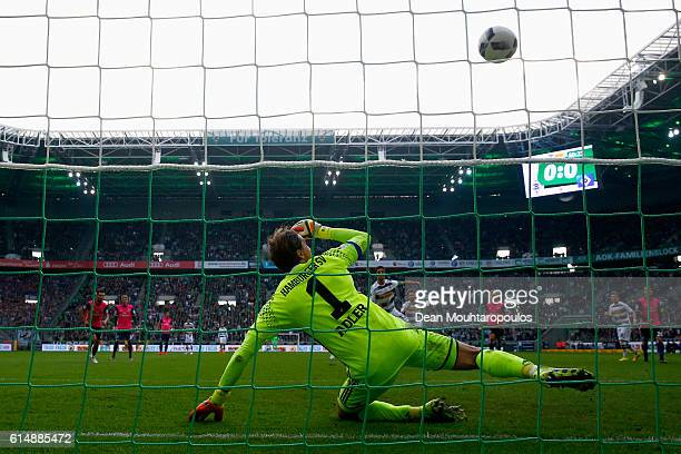 Goalkeeper Rene Adler of Hamburger SV watches the penalty from Lars Stindl of Borussia Moenchengladbach hit the crossbar and not go in during the...