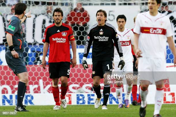 Goalkeeper Rene Adler of Leverkusen argues with referee Manuel Graefe during the Bundesliga match between VfB Stuttgart and Bayer Leverkusen at the...