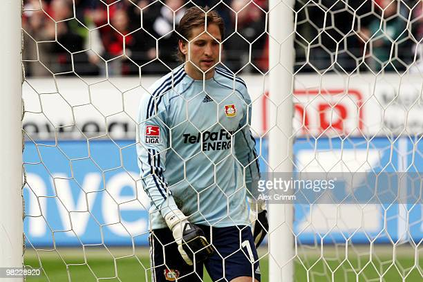 Goalkeeper Rene Adler of Leverkusen reacts after Frankfurt scored their second goal during the Bundesliga match between Eintracht Frankfurt and Bayer...