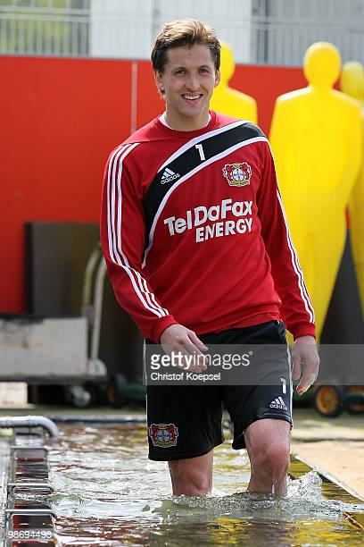 Goalkeeper Rene Adler wades through water during the training session of Bayer Leverkusen at the training ground on April 27 2010 in Leverkusen...