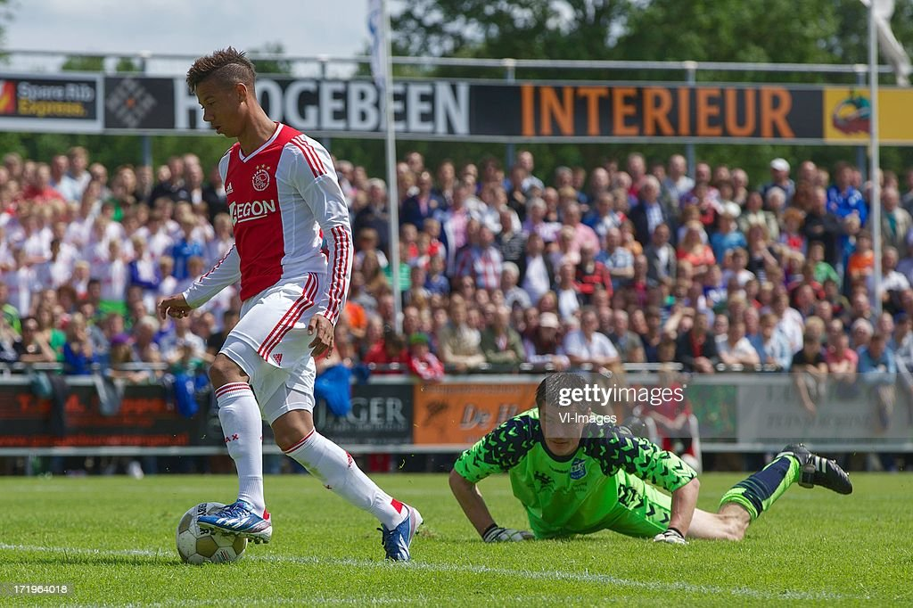 goalkeeper Rene van Hemel of SDC Putten, Tobias Sana of Ajax during the pre season friendly match between SDC Putten and Ajax on June 29, 2013 in Putten, The Netherlands.
