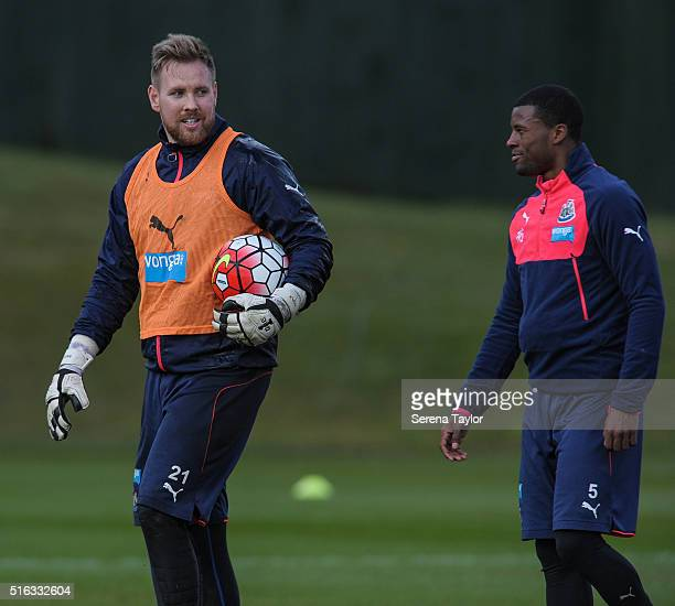 Goalkeeper Rob Elliot smiles at Georginio Wijnaldum whilst holding a ball in his hand looks on during the Newcastle United Training session at The...