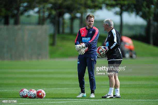 Goalkeeper Rob Elliot talks to Goalkeeping coach Simon Smith whilst holding a ball during a Newcastle United Training session at The Newcastle United...