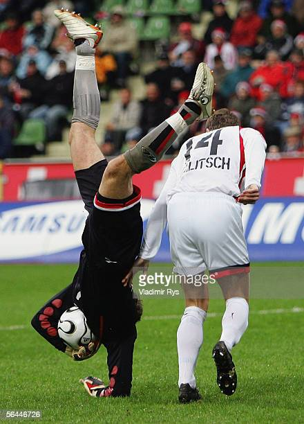 Goalkeeper Robert Enke of Hanover catches the ball as his team mate Hanno Balitsch looks on during the Bundesliga match between Bayer Leverkusen and...