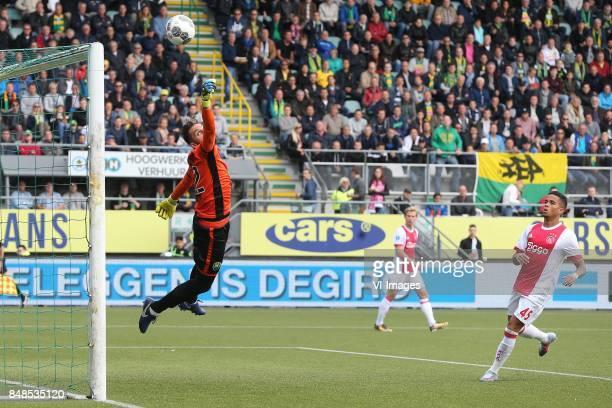 goalkeeper Robert Zwinkels of ADO Den Haag Justin Kluivert of Ajax during the Dutch Eredivisie match between ADO Den Haag and Ajax Amsterdam at Car...