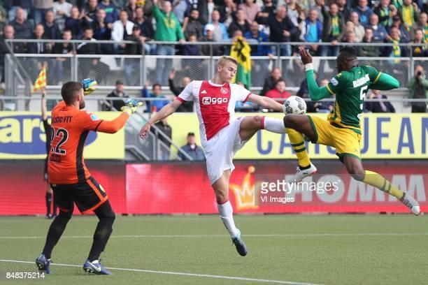 goalkeeper Robert Zwinkels of ADO Den Haag Matthijs de Ligt of Ajax Wilfried Kanon of ADO Den Haag during the Dutch Eredivisie match between ADO Den...