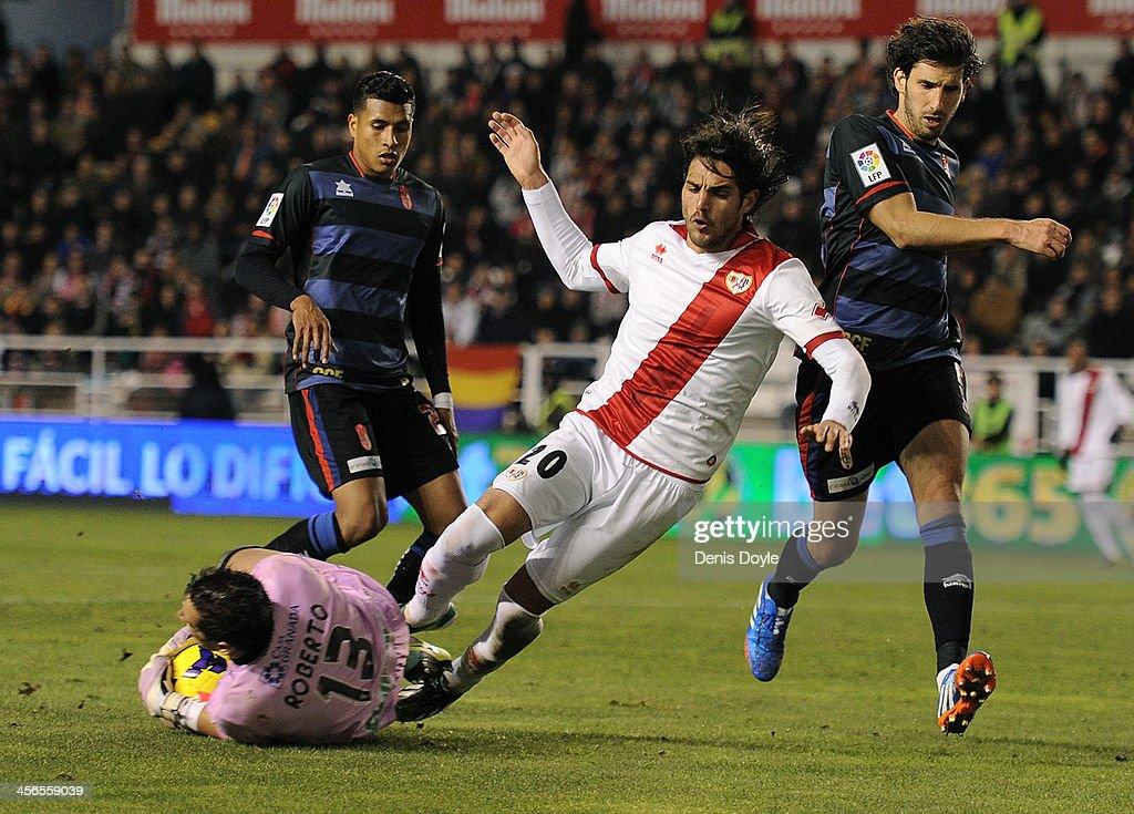 Goalkeeper Roberto Fernandez of Granada CF (L) saves the ball from Joaquin Larrivey of Rayo Vallecano de Madrid during the La Liga match between Rayo Vallecano de Madrid and Granada CF at Teresa Rivero stadium on December 14, 2013 in Madrid, Spain.