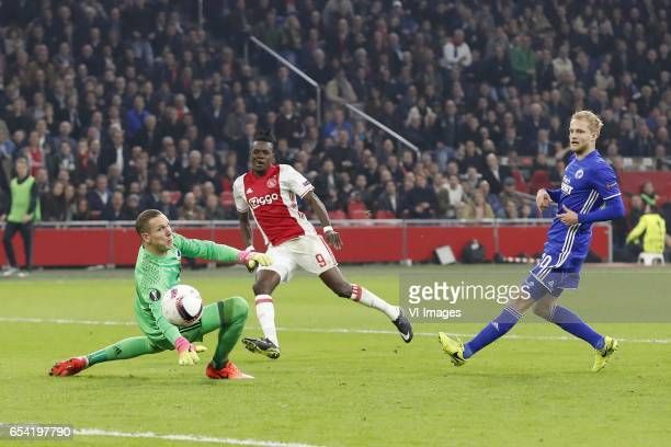 goalkeeper Robin Olsen of FC Copenhagen Bertrand Traore of Ajax Nicolai Boilesen of FC Copenhagenduring the UEFA Europa League round of 32 match...