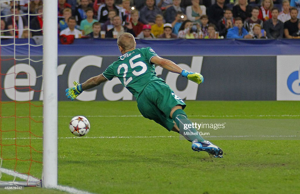 Goalkeeper Robin Olsen of Malmo FF concedes a goal during the UEFA Champions League qualifying play-off at the Red Bull Arena on August 19, 2014 in Salzburg, Austria.