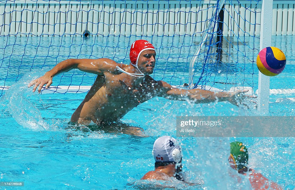 Goalkeeper Robin Randall of Canda saves a shot at goal during the Men's Water Polo first preliminary round match between Canada and South Africa during day three of the 15th FINA World Championships at Piscines Bernat Picornell on July 22, 2013 in Barcelona, Spain.