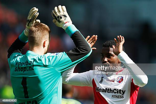 Goalkeeper Robin Ruiter of Utrecht celebrates with Gevero Markiet after the Dutch Eredivisie match between FC Utrecht and Ajax Amsterdam held at...