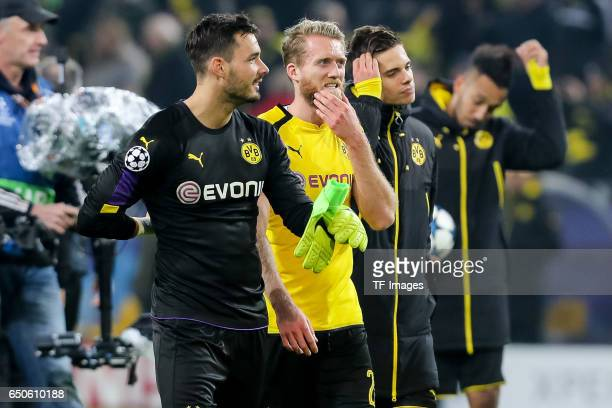 Goalkeeper Roman Buerki of Borussia Dortmund and Andre Schuerrle of Borussia Dortmund celebrate their win after the UEFA Champions League Round of 16...
