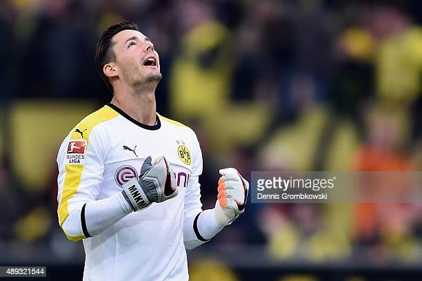 Goalkeeper Roman Buerki of Borussia Dortmund celebrates as Shinji Kagawa scores the second goal during the Bundesliga match between Borussia Dortmund...