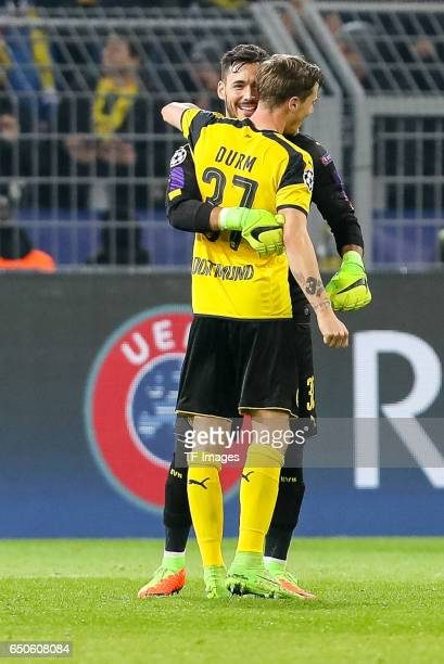Goalkeeper Roman Buerki of Borussia Dortmund Erik Durm of Borussia Dortmund celebrate their win after the UEFA Champions League Round of 16 Second...