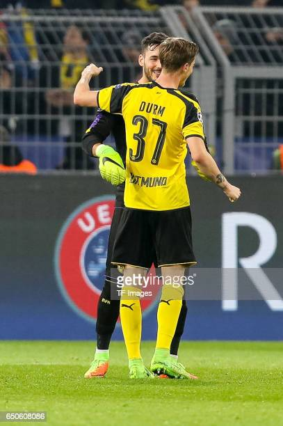 Goalkeeper Roman Buerki of Borussia Dortmund Erik Durm of Borussia Dortmund celebrate their win after the UEFA Champions League Round of 16 Second...