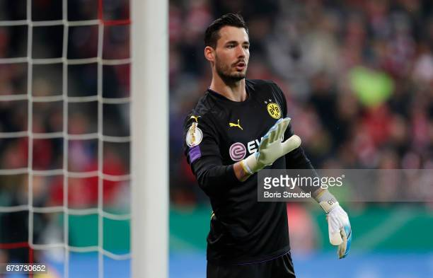 Goalkeeper Roman Buerki of Borussia Dortmund gestures during the DFB Cup semi final match between FC Bayern Muenchen and Borussia Dortmund at Allianz...