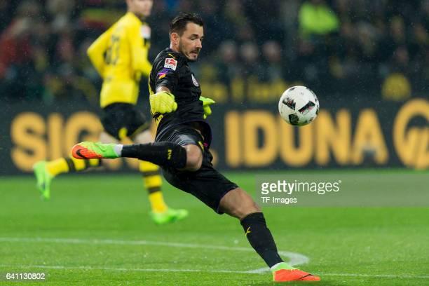 Goalkeeper Roman Buerki of Borussia Dortmund in action during the Bundesliga soccer match between Borussia Dortmund and RB Leipzig at the Signal...