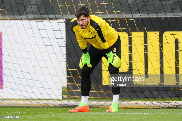 Goalkeeper Roman Buerki of Borussia Dortmund looks on prior the training of Borussia Dortmund ahead of the UEFA Champions League Round of 16 second...