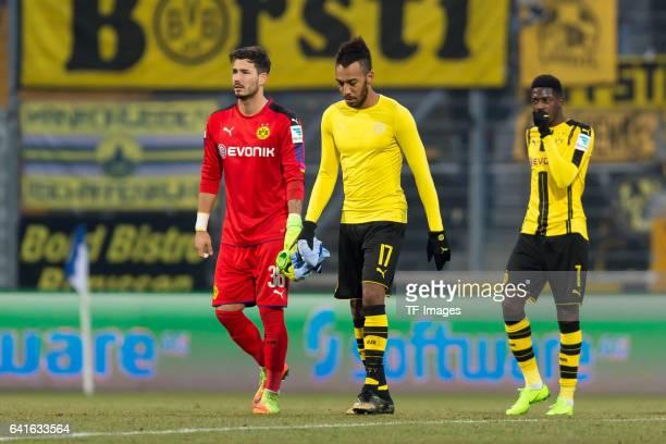 Goalkeeper Roman Buerki of Borussia Dortmund PierreEmerick Aubameyang of Borussia Dortmund and Ousmane Dembele of Borussia Dortmund looks dejected...