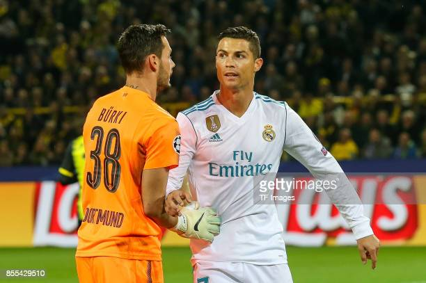 Goalkeeper Roman Buerki of Dortmund and Cristiano Ronaldo of Real Madrid looks on during the UEFA Champions League group H match between Borussia...
