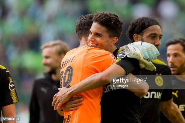 Goalkeeper Roman Buerki of Dortmund and Marc Bartra of Dortmund celebrate their win during to the Bundesliga match between VfL Wolfsburg and Borussia...