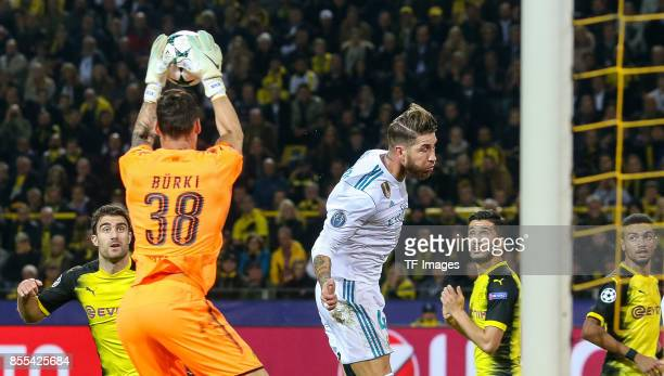 Goalkeeper Roman Buerki of Dortmund and Sergio Ramos of Real Madrid battle for the ball during the UEFA Champions League group H match between...
