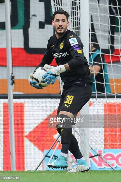 Goalkeeper Roman Buerki of Dortmund controls the ball during the Bundesliga match between FC Augsburg and Borussia Dortmund at the WWKArena on May 13...