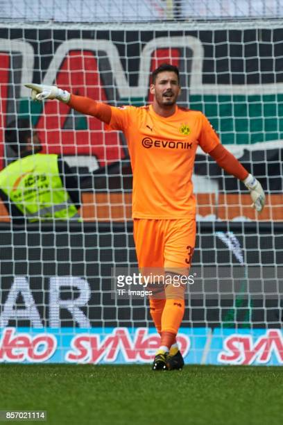 Goalkeeper Roman Buerki of Dortmund gestures during the Bundesliga match between FC Augsburg and Borussia Dortmund at WWKArena on September 30 2017...