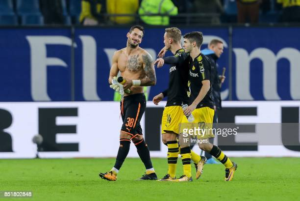 Goalkeeper Roman Buerki of Dortmund Jacob Bruun Larsen of Dortmund and Christian Pulisic of Dortmund looks on during the Bundesliga match between...