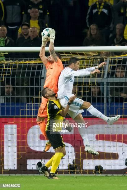 Goalkeeper Roman Buerki of Dortmund Jeremy Toljan of Dortmund and Cristiano Ronaldo of Real Madrid battle for the ball during the UEFA Champions...