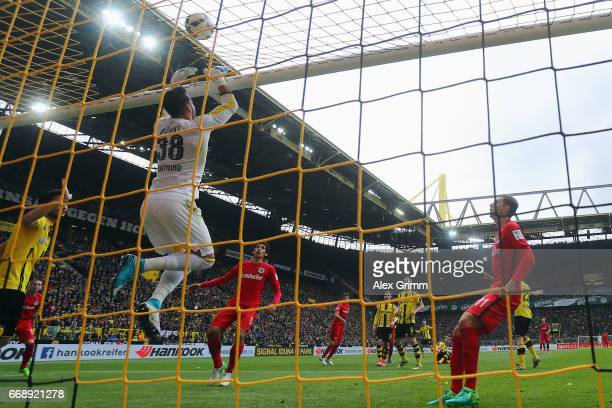 Goalkeeper Roman Buerki of Dortmund makes a save during the Bundesliga match between Borussia Dortmund and Eintracht Frankfurt at Signal Iduna Park...