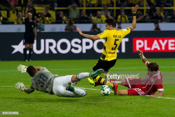 Goalkeeper Roman Buerki of Dortmund Marc Bartra of Dortmund and Thomas Mueller of Bayern Muenchen battle for the ball during the DFL Supercup 2017...