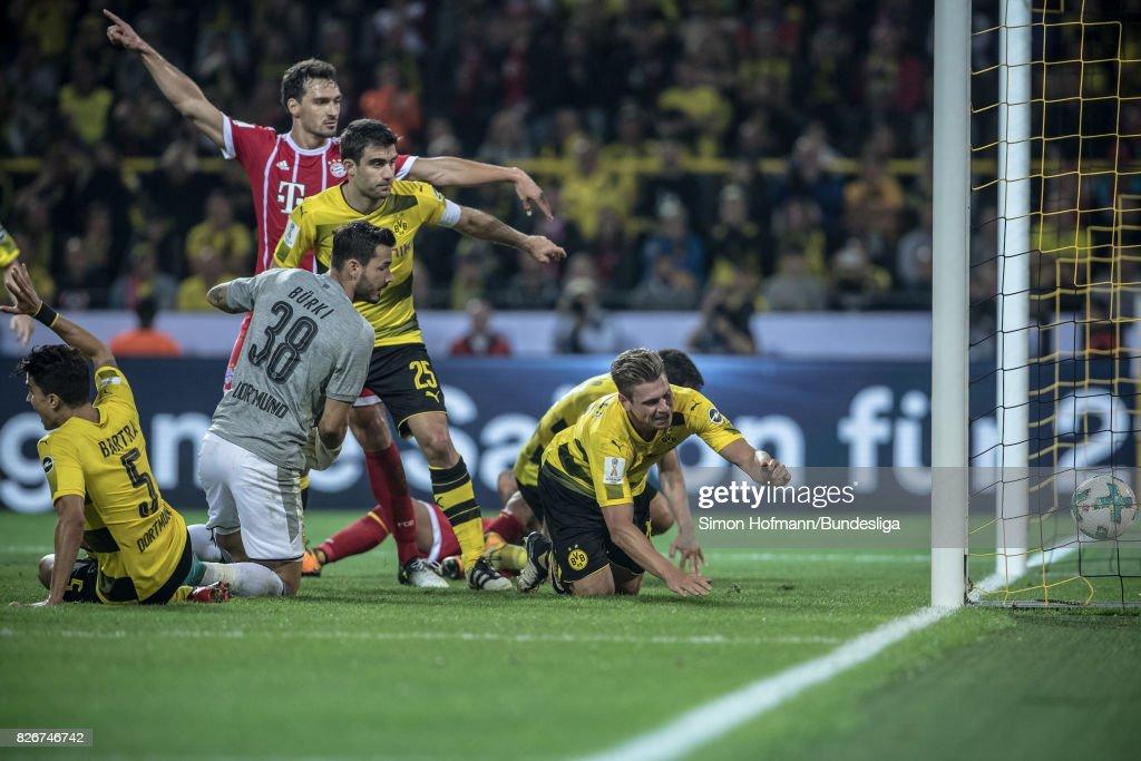 Goalkeeper Roman Buerki of Dortmund scores an own net goal during the DFL Supercup 2017 match between Borussia Dortmund and Bayern Muenchen at Signal Iduna Park on August 5, 2017 in Dortmund, Germany.