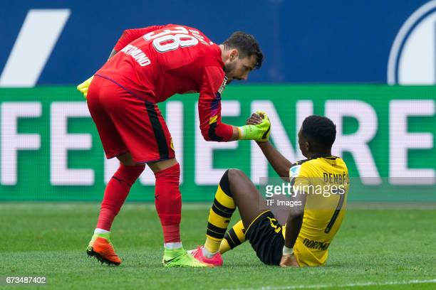 Goalkeeper Roman Buerki of Dortmund shakes hands with Ousmane Dembele of Dortmund during the Bundesliga match between FC Schalke 04 and Borussia...