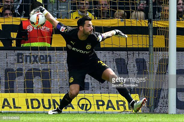 Goalkeeper Roman Buerki of Dortmund throws the ball during the Bundesliga match between Borussia Dortmund and 1 FC Koeln at Signal Iduna Park on May...