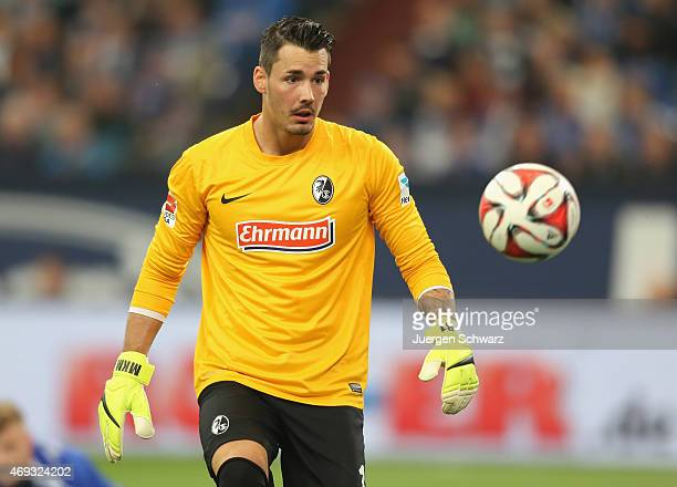 Goalkeeper Roman Buerki of Freiburg eyes the ball during the Bundesliga match between Schalke 04 and SC Freiburg at Veltins Arena on April 11 2015 in...