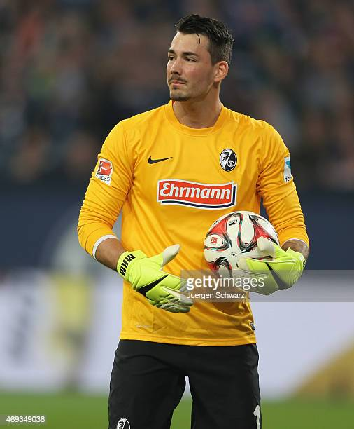 Goalkeeper Roman Buerki of Freiburg holds the ball during the Bundesliga match between Schalke 04 and SC Freiburg at Veltins Arena on April 11 2015...