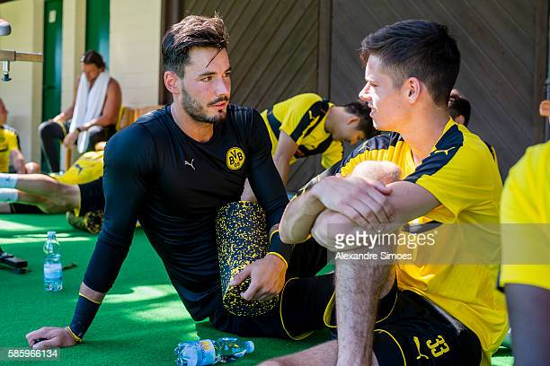 Goalkeeper Roman Buerki with Julian Weigl of Borussia Dortmund during a training session on the training ground of Bad Ragaz during Borussia...