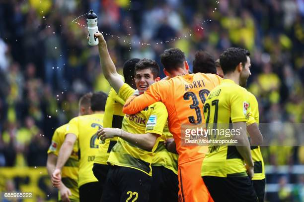 Goalkeeper Roman Burki and Christian Pulisic of Borussia Dortmund celebrate in front of the Kop or home fans after victory in the Bundesliga match...